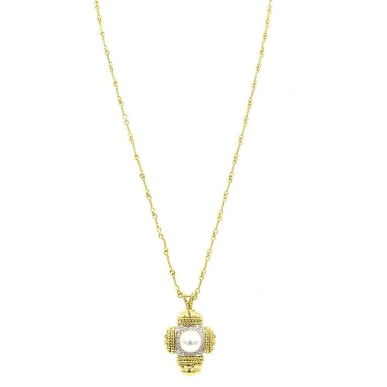 This classy and stylish diamond and white cultured pearl cross pendant, by high-end designer Cassis, is fashioned in 18 karat yellow gold. There are 22 high quality round brilliant cut diamonds that equal approximately .25 cttw. The pearl measures