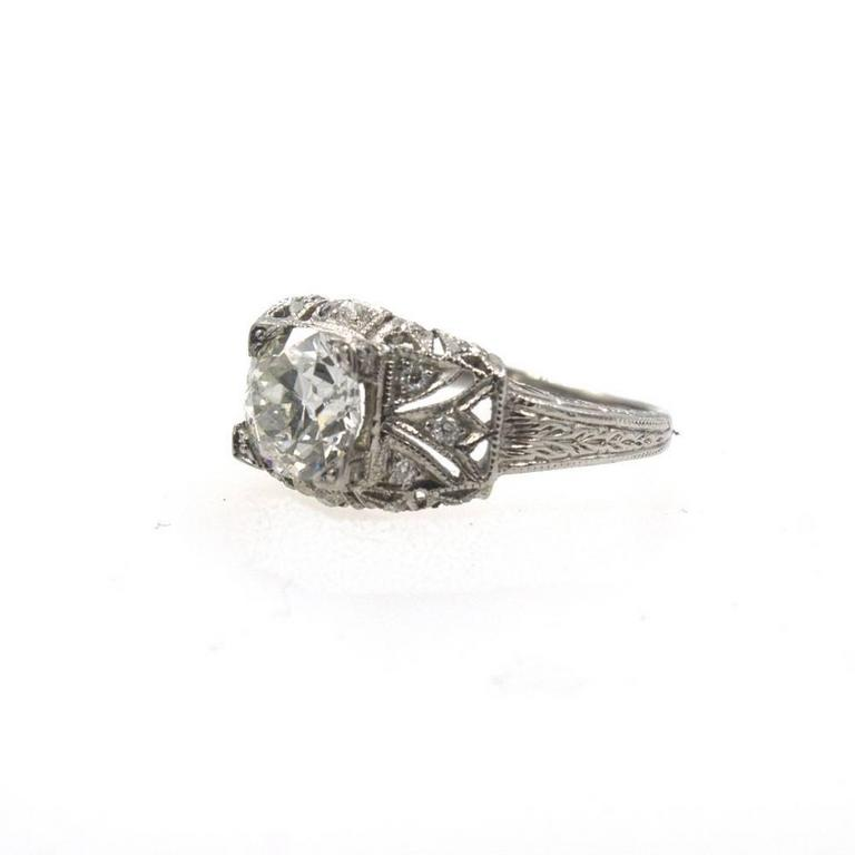 Spectacular original Art Deco engagement ring featuring an 1.24 Old European cut diamond with GIA certificate. The Old European cut  diamond is graded I color and VVS2 clarity. The original platinum filigree mounting features another .20 cttw of old