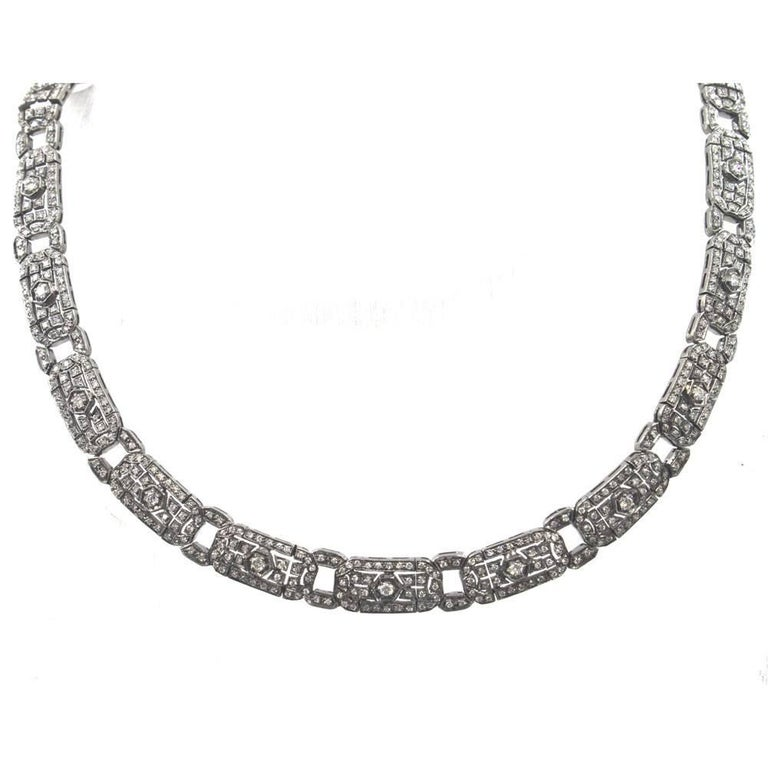 This fabulous diamond choker features 6 carats of round brilliant cut diamonds. The diamonds are set in 18 karat white gold with a black rhodium finish to give the necklace an Art Deco look.  The choker measures 15.5 inches in length and .30 inches