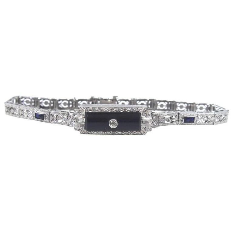 Art Deco Platinum Filigree Onyx Diamond Sapphire Bracelet In Good Condition For Sale In Boca Raton, FL