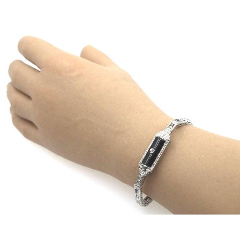 Women's Art Deco Platinum Filigree Onyx Diamond Sapphire Bracelet For Sale