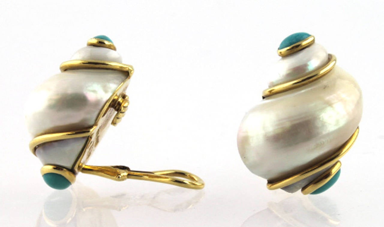 18 karat yellow gold Seamon Schepps pearl, and turquoise shell earrings from the Turbo Shell Collection. The cabochon turquoise stones are set at the top and bottom of the earrings. The earrings are clips with omega backs, signed and hallmarked
