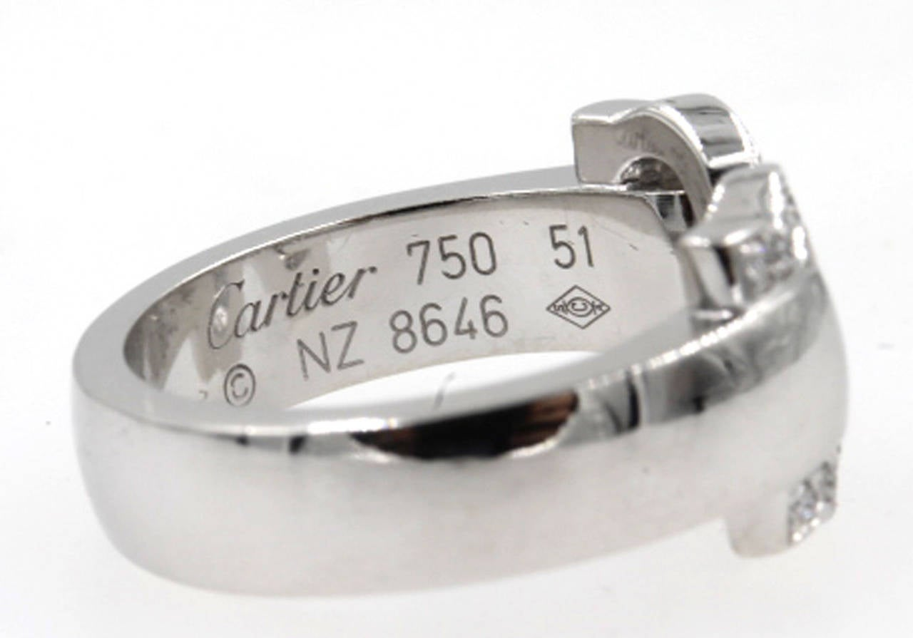 This 18 Karat white gold and diamond double C Cartier ring is from Cartier's