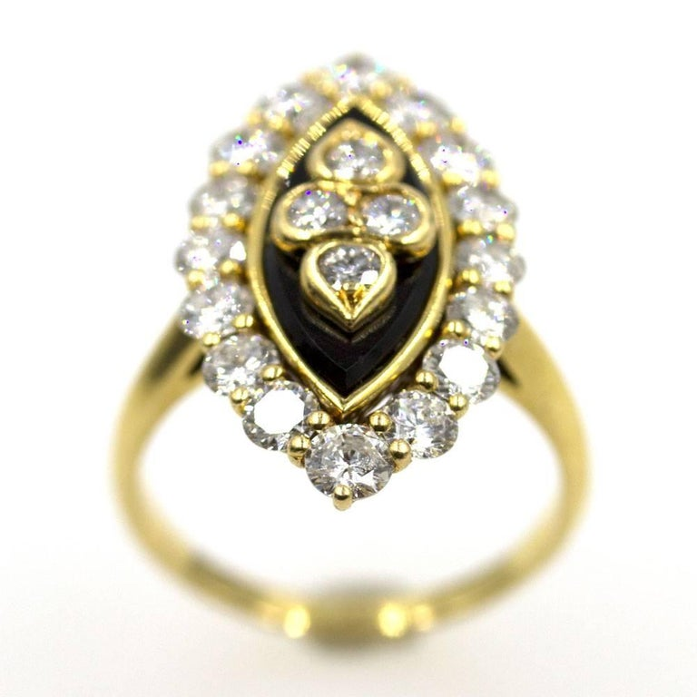 Elegant and sophisticated diamond onyx ring by Van Cleef & Arpels. This 1960's vintage ring features 20 round brilliant cut diamonds graded E color and VVS2 clarity. The diamonds sparkle next to black onyx and 18 karat yellow gold. The ring is