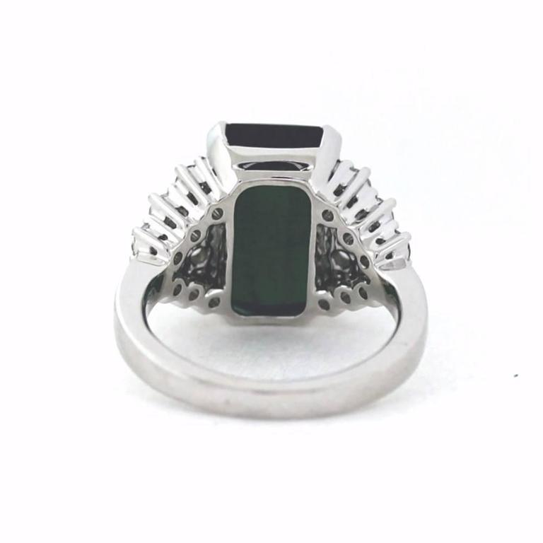 For sale is an estate Green Tourmaline and Round Diamond Cocktail Ring! It is crafted out of 18K Solid White Gold. Showcasing one (1) checkerboard Rectangular Green Tourmaline, weighing approximately 7.62 carats. Accenting the gemstone are eighteen