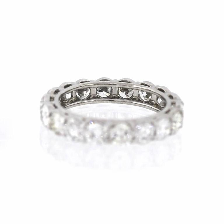 Set in platinum, this eternity band is an eye catcher.  Includes 18 diamonds  (3.36ctw) of round brilliant diamonds in the G color range and VS clarity range.    Size 6 1/2, Can be re sized up or down 1 size if necessary.