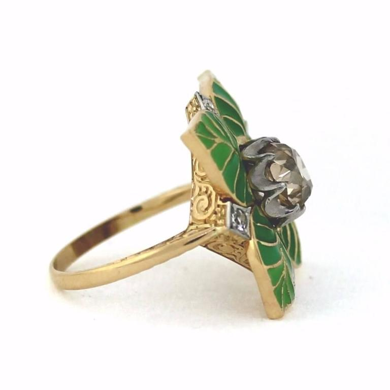 AMAZING BEAUTIFUL RING.  Art Deco period ring that has been restored to perfect condition.  Leaf design made of fine green enamel.  The center stone features a 1.96 ole mine cut diamond in the center.  Light chocolate color, Si1 clarity.  The