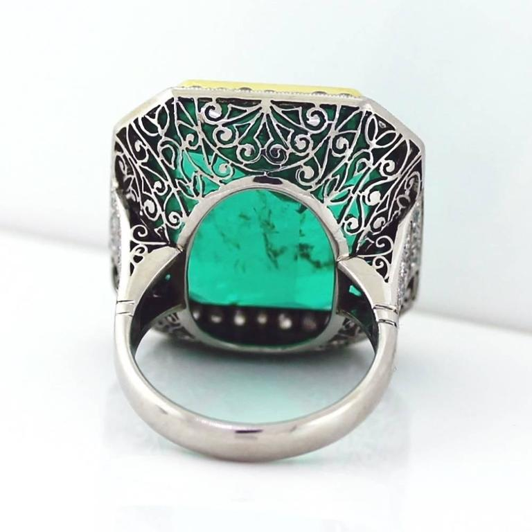 magnificent green columbian emerald ring with diamonds at