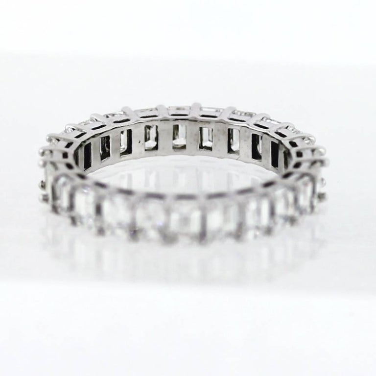 Hand Finished Eternity Band made in Platinum.  The band contains 24 Emerald Cut diamonds weighing a total of 3.55 carats.  On average, each diamond weights approximately .15ct.  The diamonds are G-H color (near colorless) and VS clarity.  This band