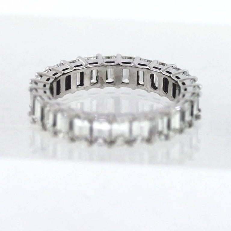 Hand Finished Eternity Band made in Platinum.  The band contains 26 Emerald Cut diamonds weighing a total of 3.92 carats.  On average, each diamond weights approximately .15ct.  The diamonds are F-H color (colorless-near colorless) and VS clarity.