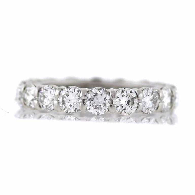 Hand Finished Eternity Band made in Platinum. The band contains 18 round brilliant cut diamonds weighing a total of 3.58 carats. On average, each diamond weights approximately .20ct. The diamonds are G-H color (near colorless) and VS clarity. This