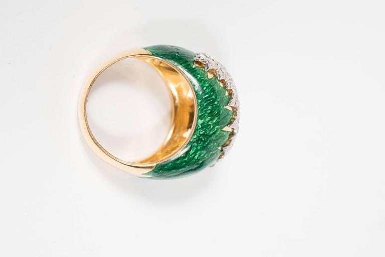 Mid-Century Modernist 18-karat gold, platinum, diamond, and green enamel band of bombe form is set with 1.30 carats of round cut diamonds weighing 16 grams inclusive, signed Webb. It is currently a size 8. This was made in New York Circa 1968. It is