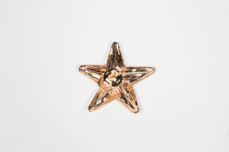 These 18k yellow gold earrings are designed as starfish and they are made by Seaman Shepps.They way 2 grams and bear the mark of Seaman Schepps.