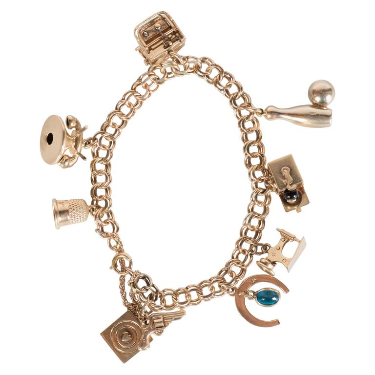 Mid-Century Classic Eight Charm Gold Link Bracelet