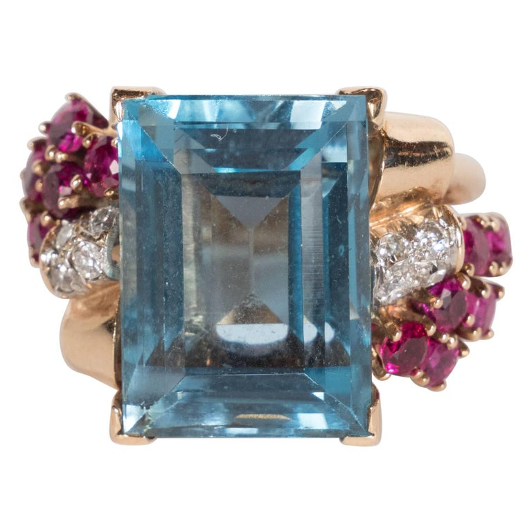 1940s American 8 Carat Acquamarine and 14k Gold Ring with Rubies and Diamonds