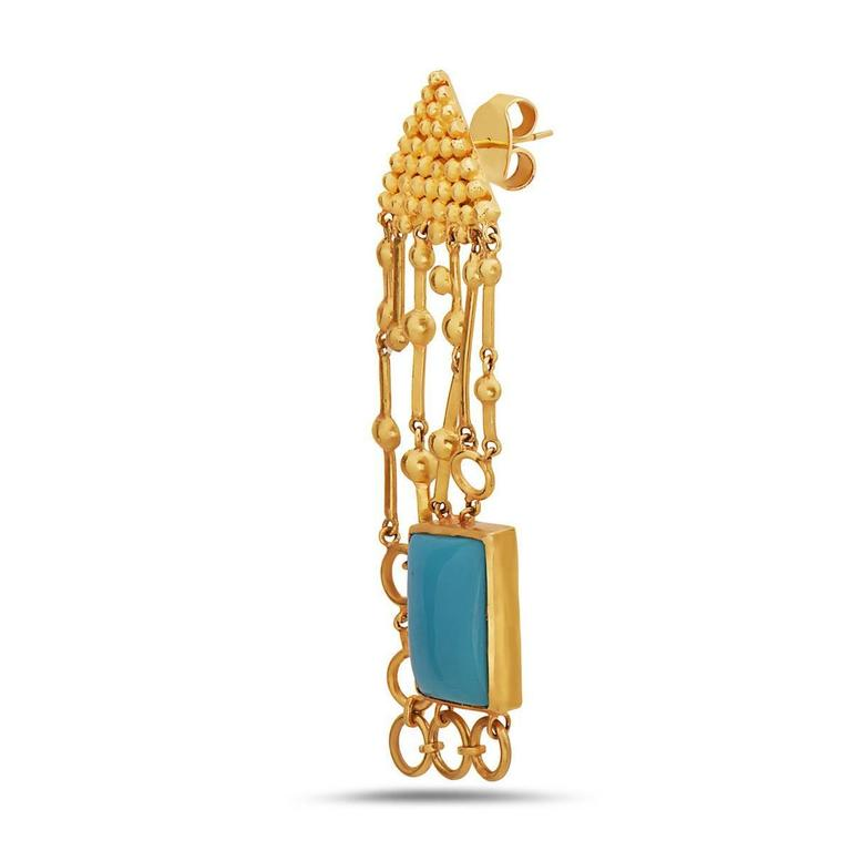 Temple jewelry looking Turquoise Earring made in 18K Gold.  Closure: Push Post  Turquoise: 14.50 cts Gold: 18K 15.56gms