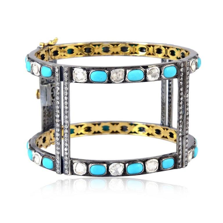 Open geometric style turquoise and diamond openable cuff bangle.  18k:3.25g Diamond: 7.93ct Sl:39.434g TURQUOISE:12.9ct