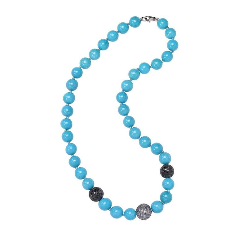 Perfect for a winter and a summer party this very charming beaded Turquoise Necklace with center Champagne diamond Ball & 2 black diamond Balls hand knotted. This necklace is openable with a lobster clasp. 