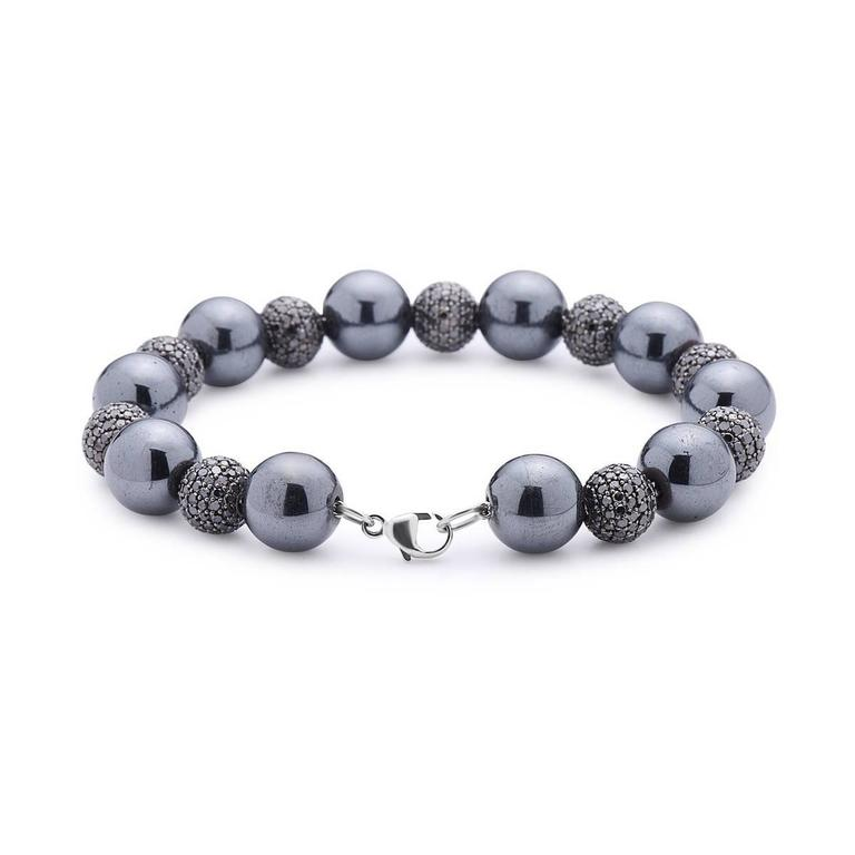 Chic Tennis Black Diamond Ball Bracelet is an excellent piece to match any of your black outfit. It is 7 inch long but the size can be adjusted if requested. The balls are 8mm diamonds with alternate 10mm hematite passing through 14K white gold