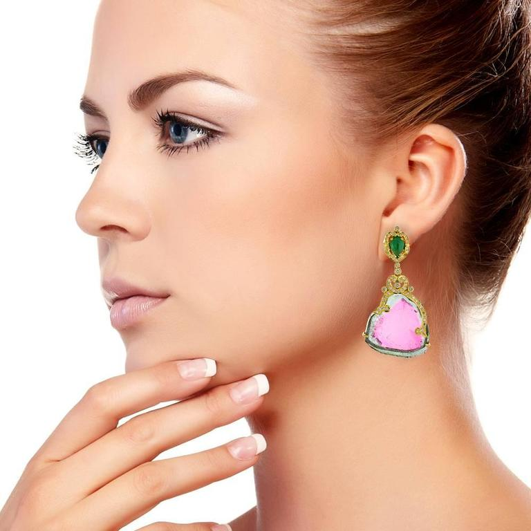 This ravishing 18K Yellow Gold Watermelon Sliced Tourmaline Earring with diamonds and emerald is handcrafted designed with gold with pave diamonds. 