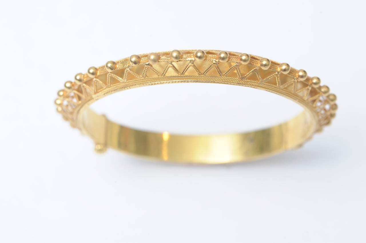 22K gold hinged bracelet with incredibly fine granulation work in the Etruscan revival style.  Circa 1970's India.  The bracelet hinges and opens with a screw clasp that will not advance all the way out.    Fine Jewelry Located on Nantucket Island