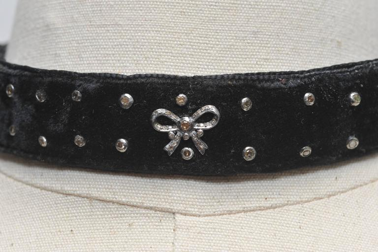 Sexy and cool black velvet choker with inset diamond studs and bows in oxidized sterling silver.  Rows of diamonds on the back bar closure and pave`-set diamonds on the lobster claw clasp and ring at the back.  The inside is black velvet and the