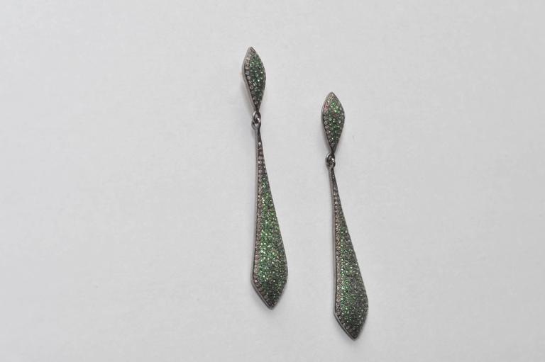 Pair of pave`-set tsavorite stone earrings bordered with diamonds, set in oxidized sterling with 18K gold post for pierced ears.  Carat weight is 1.88; the diamond weight is .72.