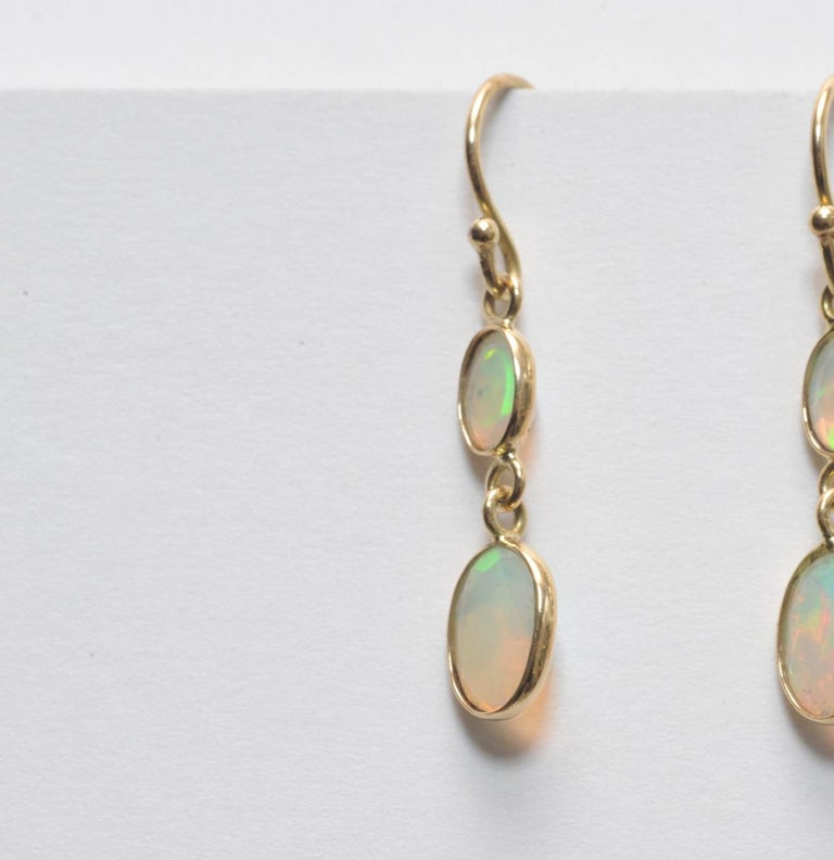 Oval Cut Double drop Faceted Opals and 18K Gold Earrings For Sale