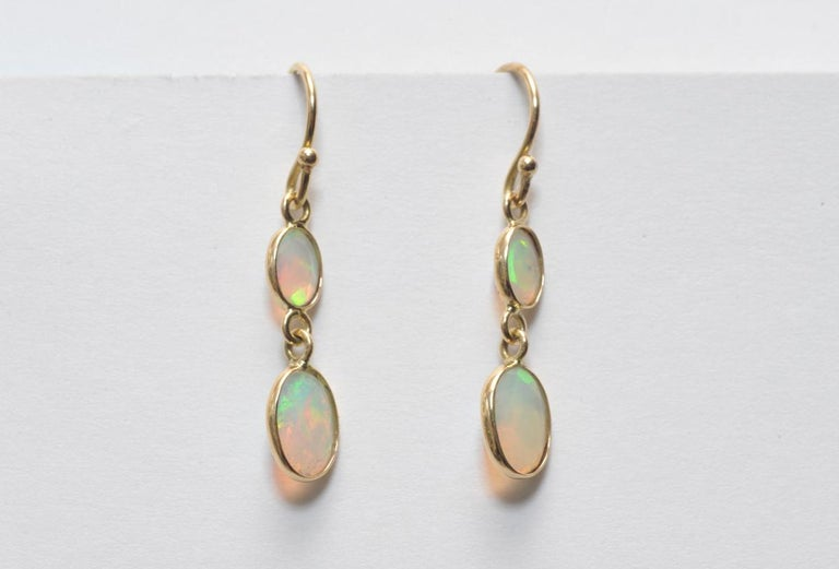 Double drop Faceted Opals and 18K Gold Earrings In Excellent Condition For Sale In Nantucket, MA