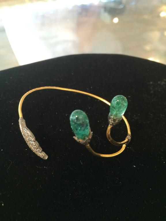 Lovely and delicate 18K gold wrap bracelet with pave` set diamonds on the oxidized sterling leaf, opposite triangle and end caps sitting above the large emeralds.  You can wear this either way, with the emeralds facing up the arm or closer to the