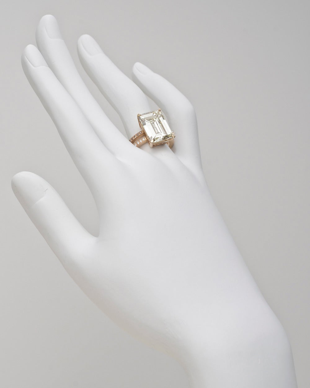 Diamond dress ring, centering on an emerald-cut fancy light brownish yellow diamond weighing 9.54 carats, with partway bead-set diamond split shanks with white and fancy brown-colored diamond accents, mounted in 18k yellow gold. Accompanied by the