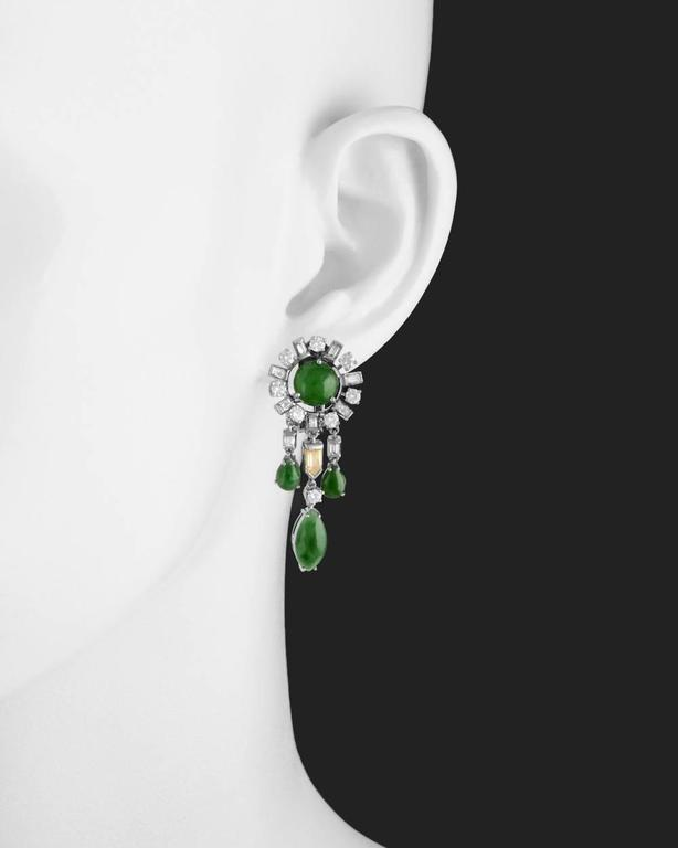 Chandelier-style earrings, designed with a cabochon-cut round jade surrounded by alternating baguette-cut and round-cut white diamonds at top suspending three multicolored diamond and cabochon-cut jade drops, the middle drop with a bullet-cut fancy