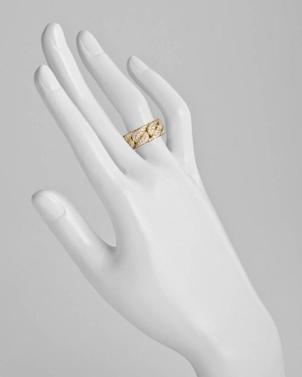 """La Dona"" band ring, showcasing pavé-set diamond geometric links, in 18k yellow gold, numbered NW1751, signed Cartier. 8mm band width. Size 5.75 (European - 51)."
