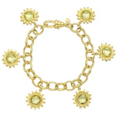 Bielka Yellow Gold and Peridot Sunflower Charm Bracelet