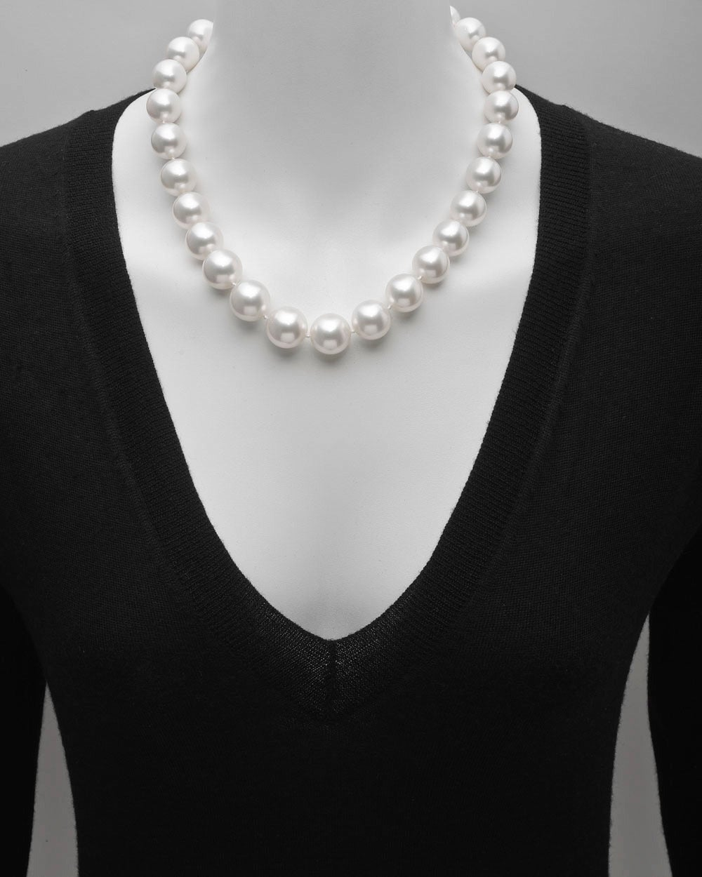 """Single strand South Sea pearl necklace, composed of 29 fine South Sea cultured pearls, ranging from 14 to 16.8mm in diameter, strung on a silk cord, with a fluted oval-shaped clasp in 18k white gold accented by a row of round diamonds. 19.5"""""""