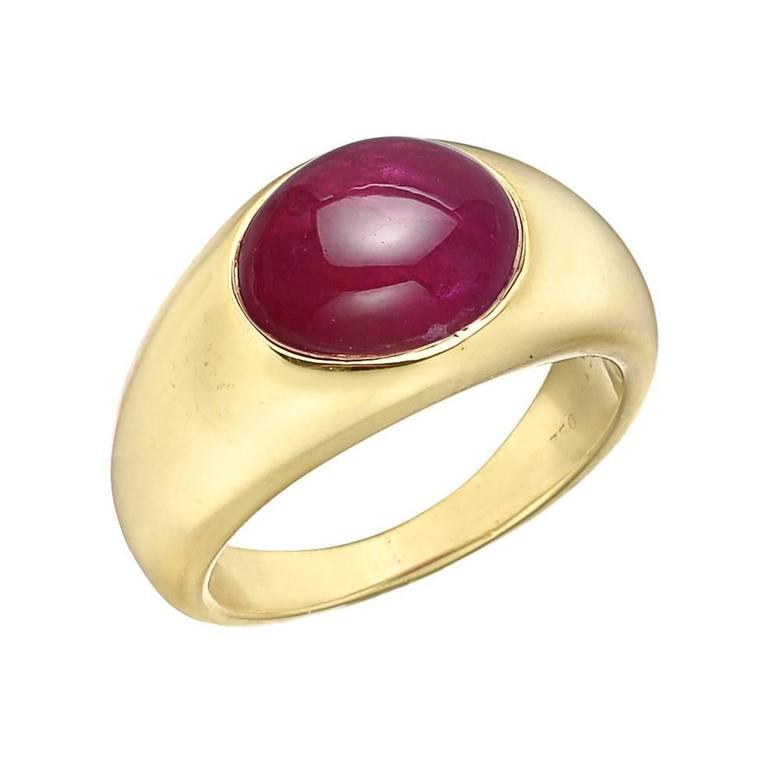 Vintage dress ring, centering a gypsy-set oval-shaped cabochon Burmese ruby weighing approximately 6 carats, mounted in a wide polished 18k yellow gold band that tapers towards the back, signed Bvlgari. Accompanied by the Bulgari ring box. Size 6.25.
