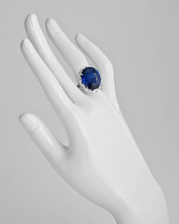 Ceylon sapphire and diamond ring, centering on an oval-shaped sapphire weighing 22.22 carats, with an oval-shaped diamond surround weighing approximately 4.10 total carats, mounted in platinum. Re-sizable.