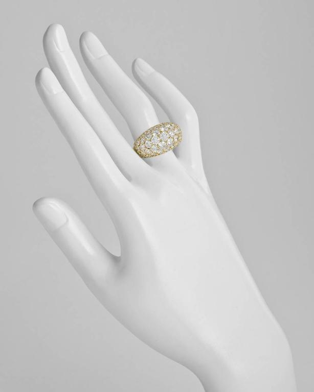 Pavé diamond dome ring, set with 75 round diamonds graduating in size and altogether weighing approximately 7.00 total carats, the ring measuring 14mm across at the widest point and tapering to the base, mounted in 18k yellow gold, numbered 143404,