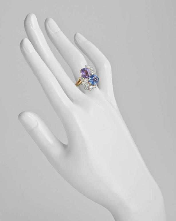 Multicolored sapphire and diamond twin ring, centering on a cushion-shaped blue sapphire weighing approximately 2.45 carats and a cushion-shaped purple sapphire weighing approximately 2.58 carats, accented by a circular-cut diamond cluster on either