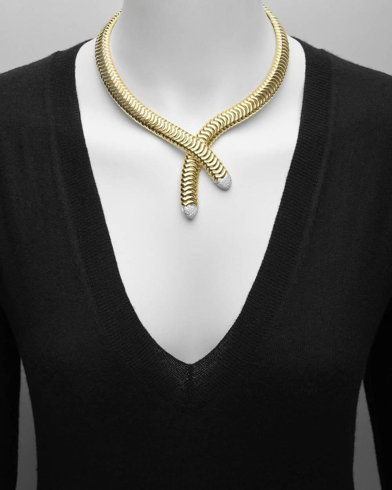 "Crossover-style collar necklace in polished 18k yellow gold, the ends pavé-set with sixty near-colorless round brilliant-cut diamonds weighing approximately 0.78 total carats (G color, VVS-VS clarity), signed Garavelli. 16.5"" approximate length"