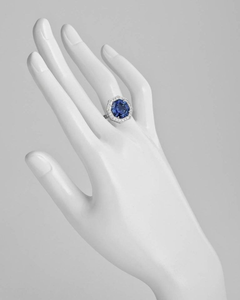 Sapphire cocktail ring, showcasing an octagonal-shaped natural Ceylon sapphire weighing 7.22 carats (certified: no indications of heat treatment), framed by two rows of round-cut diamonds with round-cut diamond-set shoulders, mounted in 18k white
