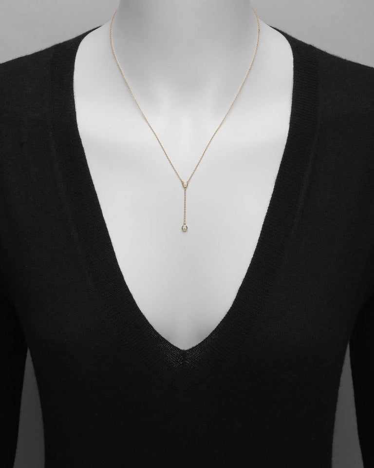 """""""Diamonds by the Yard"""" collection 'Y' chain necklace, featuring two bezel-set round brilliant-cut diamonds weighing approximately 0.12 total carats (F color/VVS1-VVS2 clarity), in 18k rose gold, signed Elsa Peretti for Tiffany & Co."""
