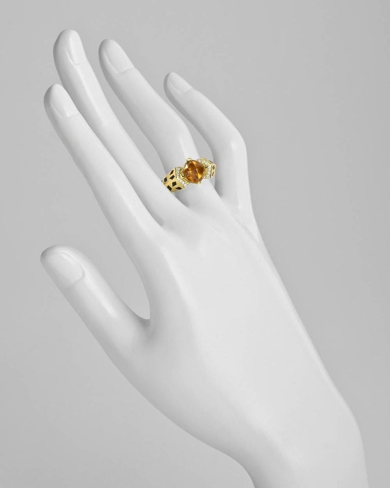 Panthère de Cartier ring, centering a sugarloaf cabochon-cut citrine flanked by round-brilliant-cut diamond accents, in 18k yellow gold with black enamel spots, numbered '10653B' and signed Cartier. Twenty diamonds weighing approximately 0.50 total