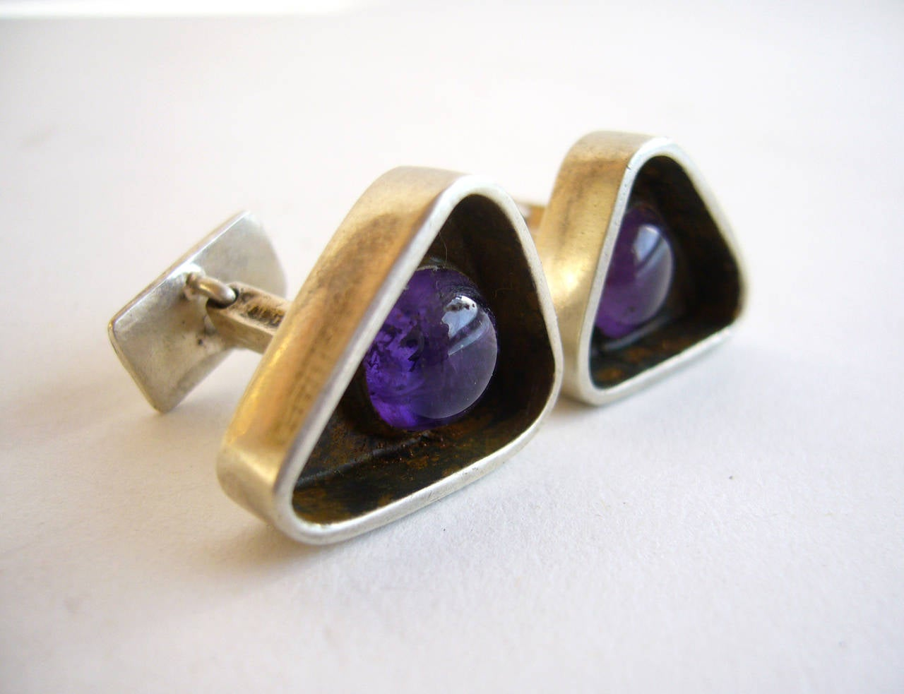 Amethyst and sterling cufflinks created by Ed Wiener of New York, circa 1950's.  Triangular shaped cufflinks measure 5/8