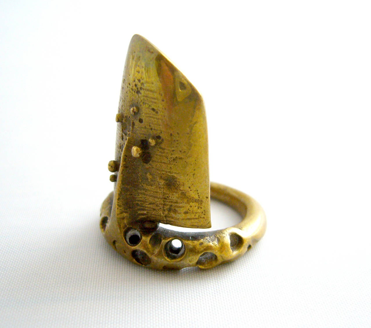An unusual, textured bronze ring created by Jack Boyd of San Diego circa 1960's.  Ring is a finger size 5.5 - 6 and is unsigned.  In excellent vintage condition.