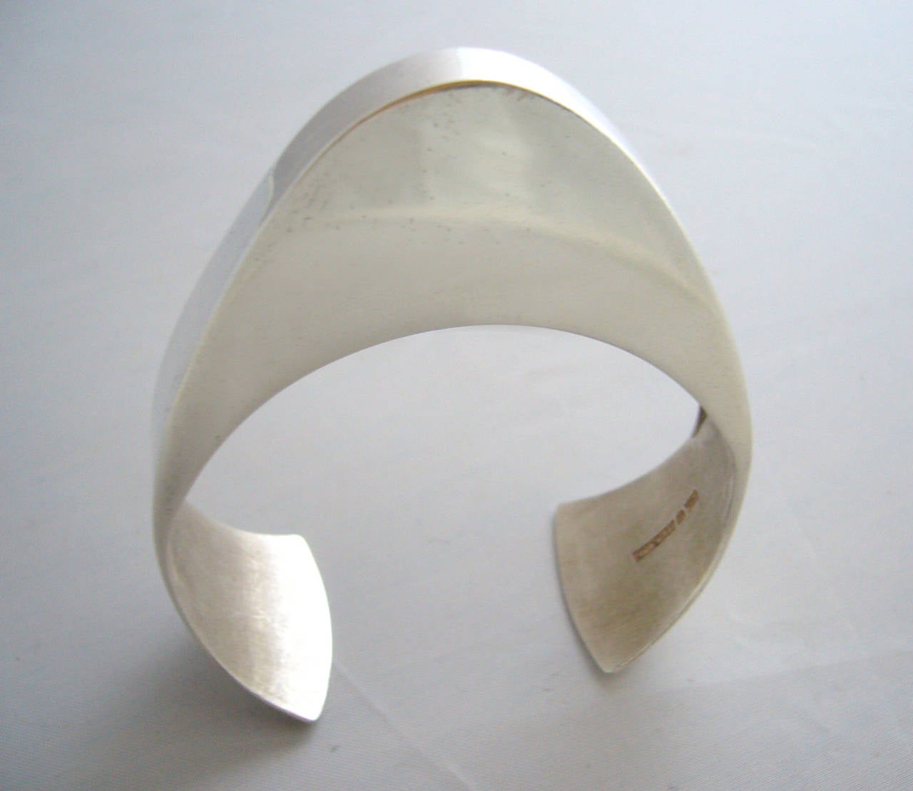 "Large scale sterling silver bracelet by Pekka Piekainen for Auran Kultaseppa of Finland, circa 1973.  Bracelet has an interior measurement of about 6 3/4"", including gap and is slightly adjustable.  Made for a small to medium wrist.  In very good"