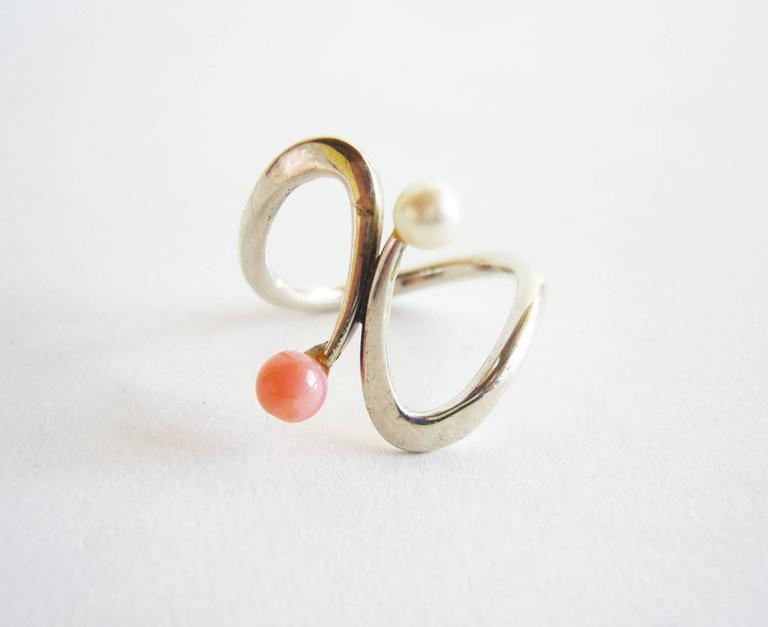 Handmade, sterling silver, coral and pearl American modernist ring created by Jack Nutting of San Francisco.  Ring is a finger size 5.5 - 6 and is unsigned.  From the estate of the artist, Jack Nutting.  A great, unconventional alternate to a modern