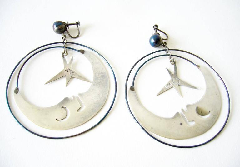 Man in the moon with stars kinetic mobile earrings created by Los Castillo of Taxco, Mexico circa 1960's.  Earrings are of the screwback variety and measure 3 5/8