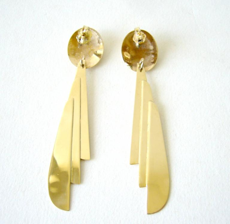 14k gold, light as a feather pierced earrings circa 1970's or 1980's, Disco era.  These earrings measure about 2.75