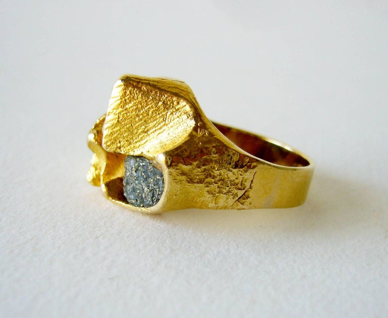 1970's 18K textured gold and copper ore ring designed and created by Master jeweler and sculptor Bjorn Weckstrom of Finland.  Ring is entitled Polyphemus, the giant son of Poseidon and Thoosa in Greek mythology.  Ring is a finger size 6 and is